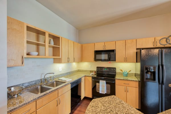 Kitchen with an island at Downtown Belmar Apartments