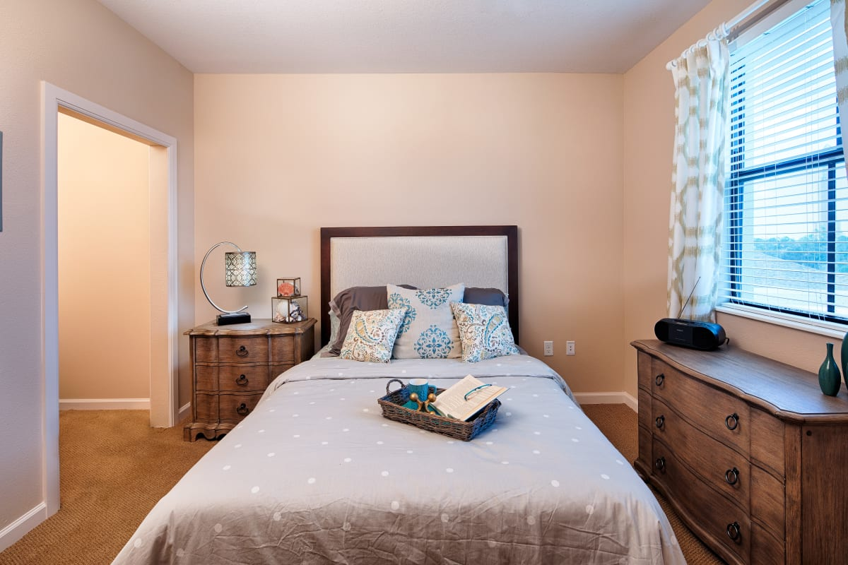 A spacious resident bedroom at The Fountains of Hope in Sarasota, Florida.