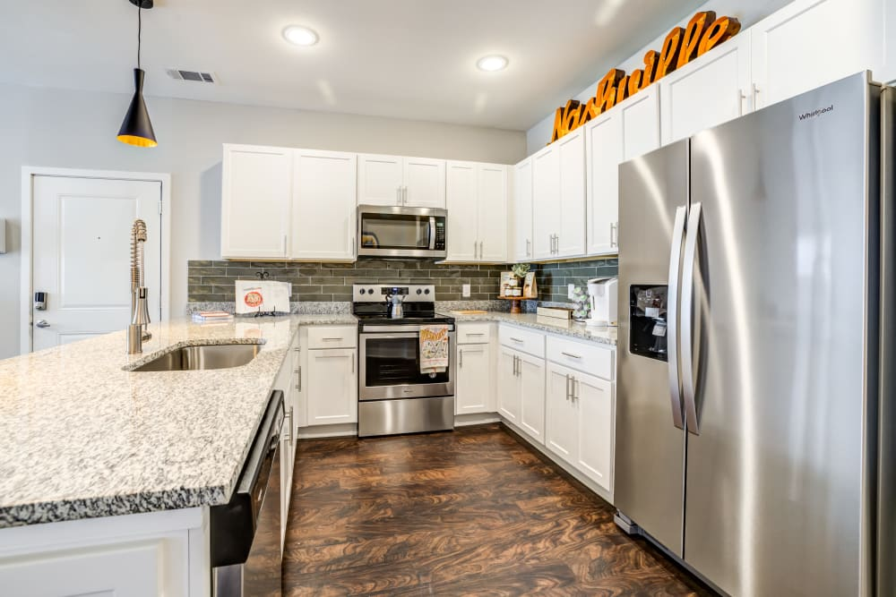 Kitchen with stainless-steel appliances at Rivertop Apartments in Nashville, Tennessee