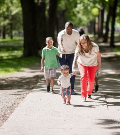 Family going for a walk near Brockport Landing in Brockport, New York