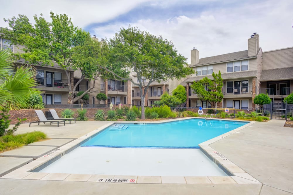 Gorgeous swimming pool at Enclave at Water's Edge Apartments in Austin, Texas