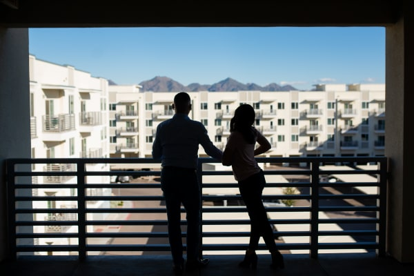 Residents admiring the view from their private balcony at Slate Scottsdale in Phoenix, Arizona