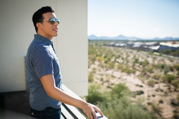 Resident admiring the view from his private balcony at Mira Santi in Chandler, Arizona