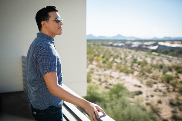 Resident admiring the view from his private balcony at San Travesia in Scottsdale, Arizona
