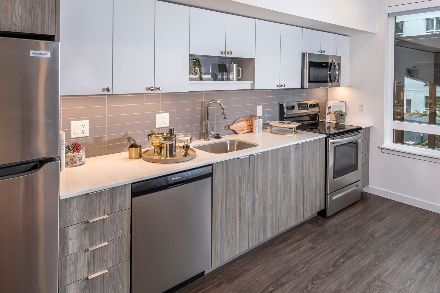 Model kitchen with stainless-steel appliances at Nightingale in Redmond, Washington