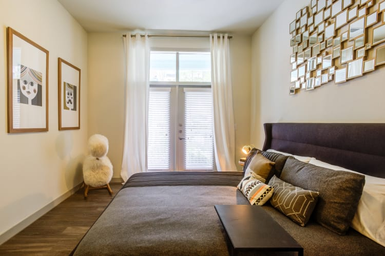 Ceiling fan and plush carpeting in a model home's master bedroom at Agave in San Antonio, Texas