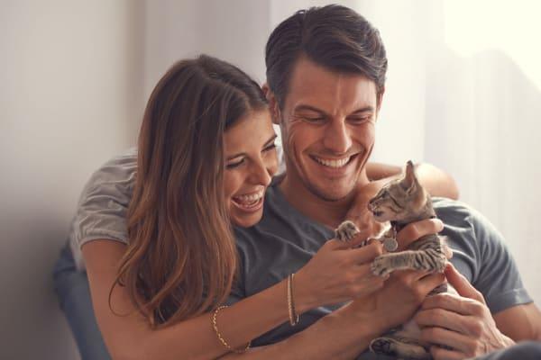 Young couple holding kitten at Maverick Apartments in San Antonio, Texas
