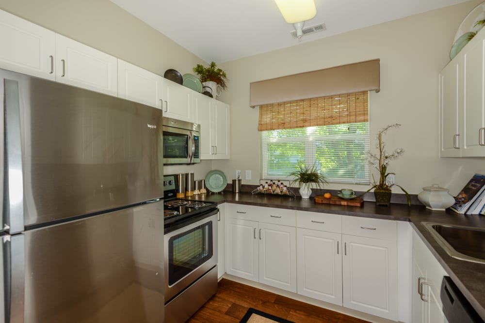 Bright kitchen with modern stainless steel appliances at Sofi Danvers in Danvers, MA