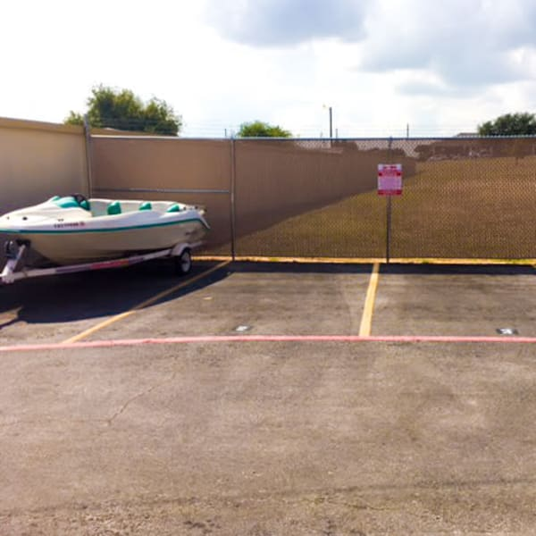 Boat, RV, and auto parking spaces at StorQuest Self Storage in Fort Worth, Texas