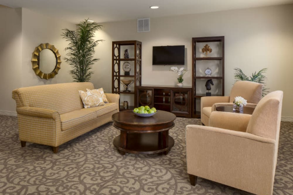 An entertainment area with inviting seating at Gentry Park Orlando in Orlando, Florida