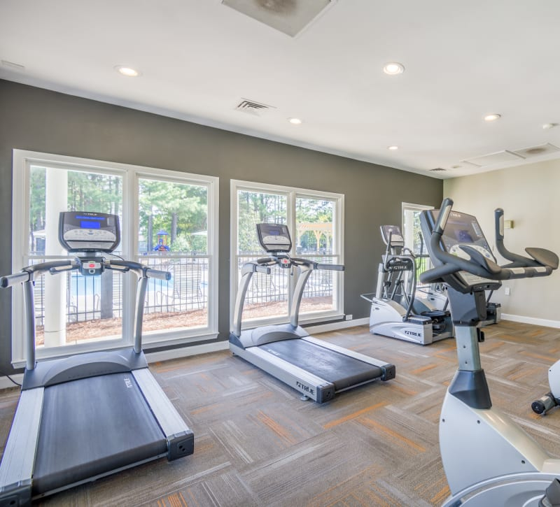 A fitness center with treadmills at The Harlowe in Charlotte, North Carolina