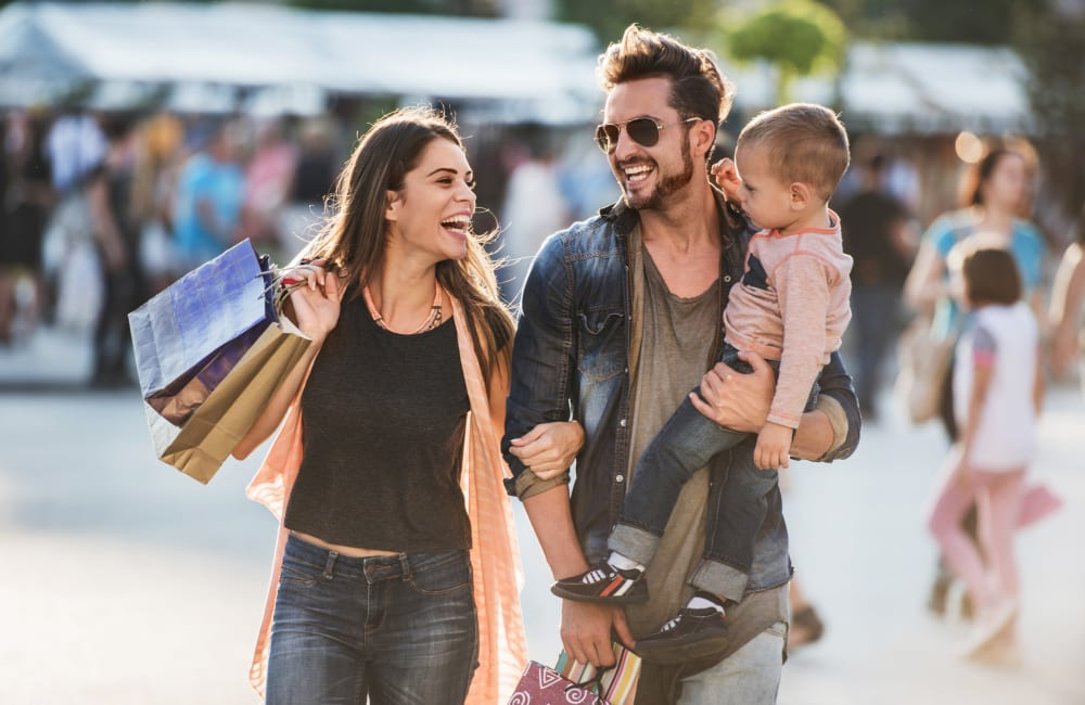 Resident family shopping at a near by store at Huntersville Apartment Homes in Huntersville, North Carolina