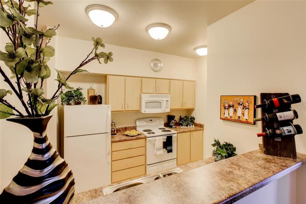 Bright and modern kitchen in model home at Woodland Apartments in Olympia, WA