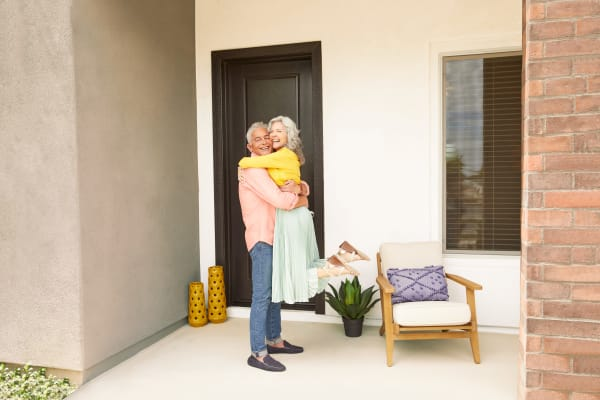 Residents at the door of Las Casas at Windrose in Litchfield Park, Arizona
