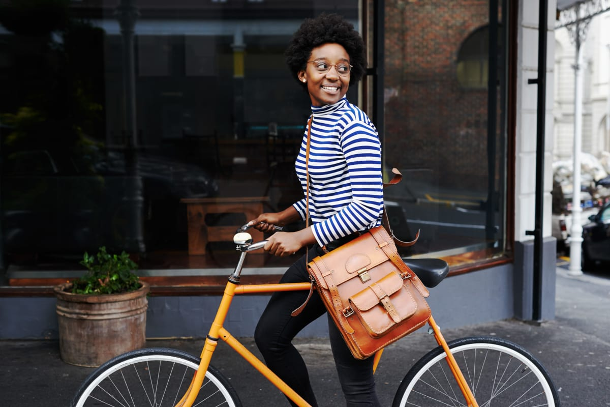 Employee biking to job at Bellrock Real Estate Partners in Fort Worth, Texas