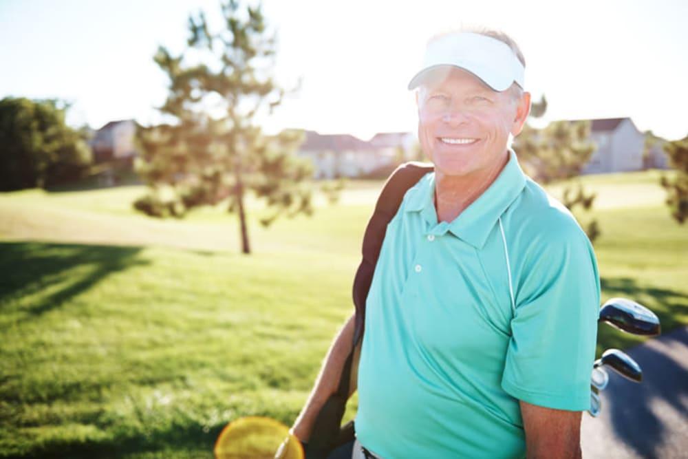 Resident playing golf near The Vista in Esquimalt, British Columbia