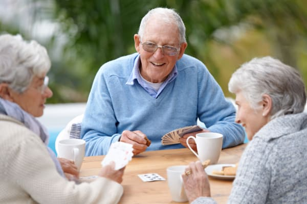 Residents playing cards at WellQuest of Granite Bay in Granite Bay, California