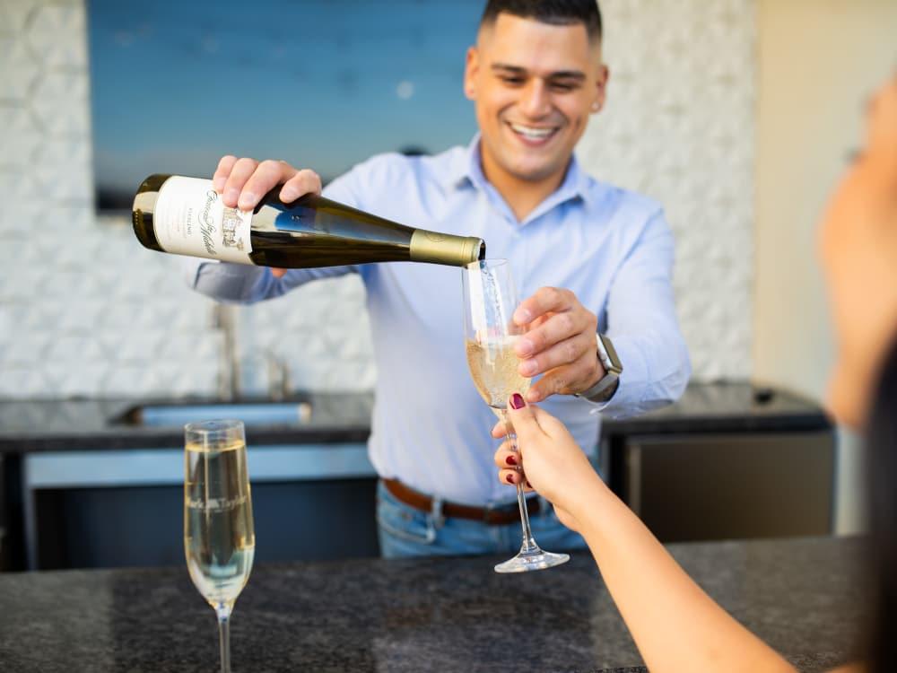 Resident enjoying wine near Lakeside Drive Apartments in Tempe, Arizona