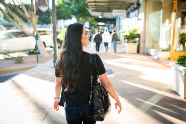 Resident walking around downtown near Avant at Fashion Center in Chandler, Arizona