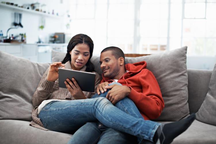 Couple enjoying their apartment at Whitestone Village Apartment Homes