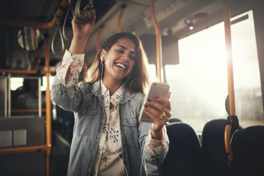 Resident student riding the bus to school from a transit stop very close to The Landmark Apartment Homes in Sunnyvale, California