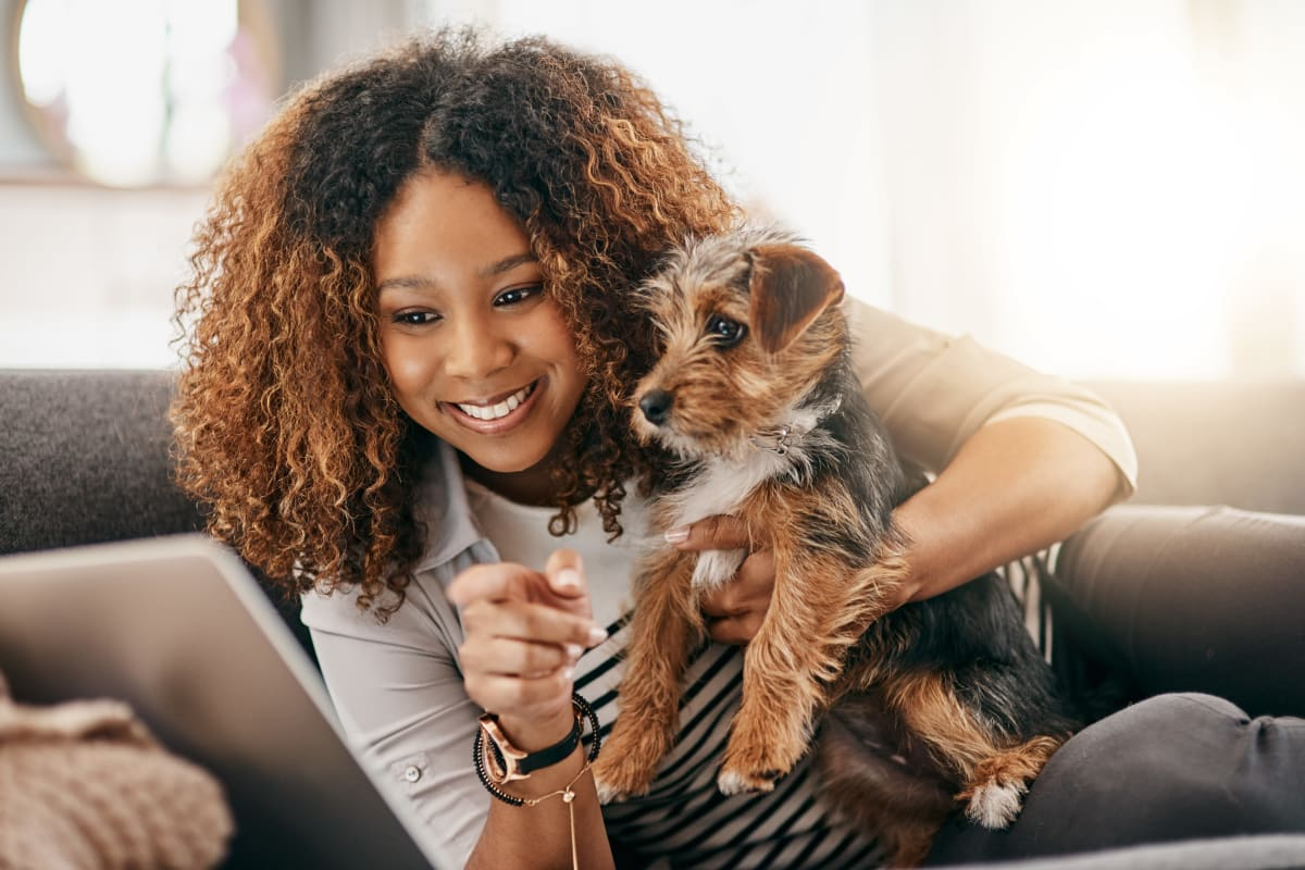 Resident and her dog enjoying their new home at Brighton Place in Midvale, Utah