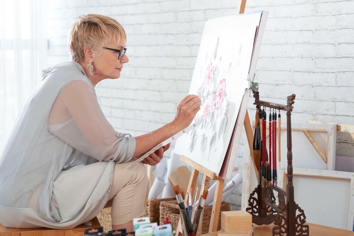 Resident enjoying painting at the senior living facility at Monark Grove Clarkston in Clarkston, Michigan