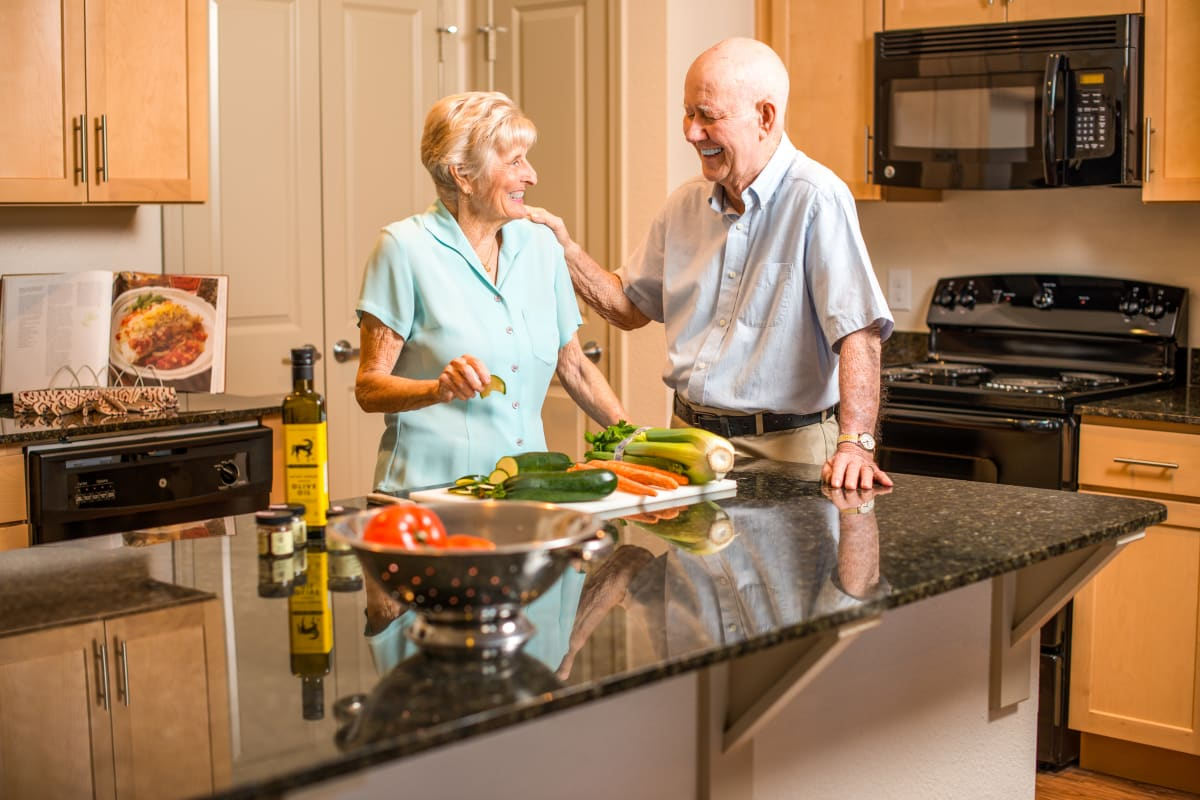 Resident couple in their kitchen at Watermere at the Preserve in Southlake, Texas