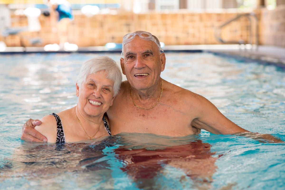 Couple enjoying the swimming pool at Watermere at the Preserve in Southlake, Texas