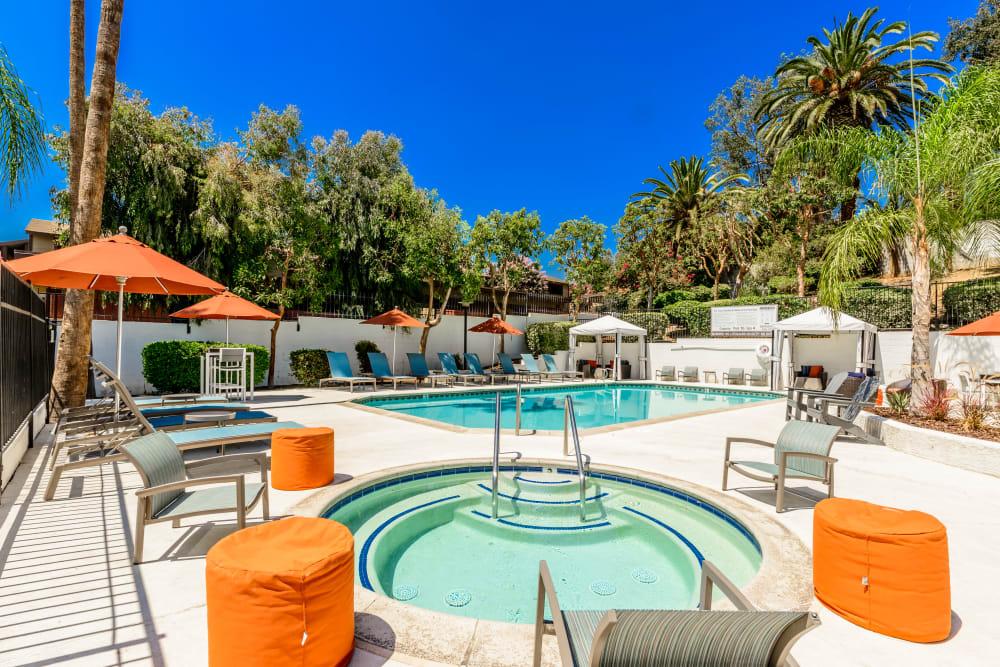 Resident pool with orange umbrellas  Sonora at Alta Loma in Alta Loma, California.