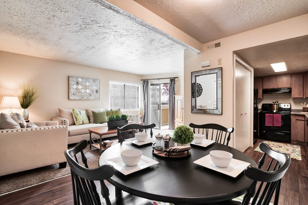 Dining Area & Living Room at Cherry Creek Apartments in Riverdale, Utah
