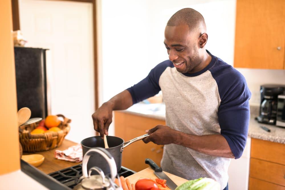 Man cooking at Liberty Square