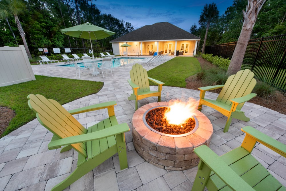 Adirondack chairs around the fire pit at The Enclave in Brunswick, Georgia