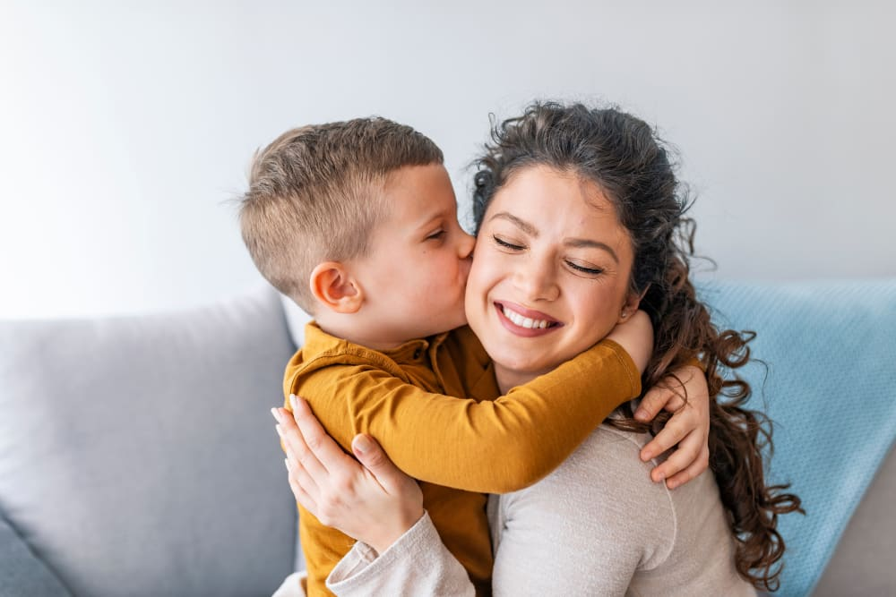 A mom and son hugging at Deer Valley Apartment Homes in Roseville, California