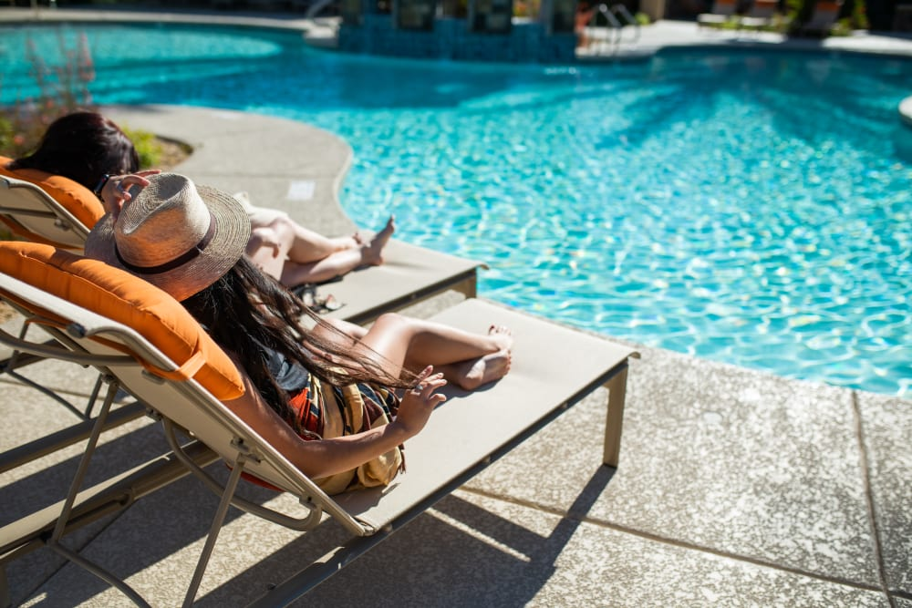 Swimming pool with a sundeck and chairs at TerraLane at Canyon Trails in Goodyear, Arizona