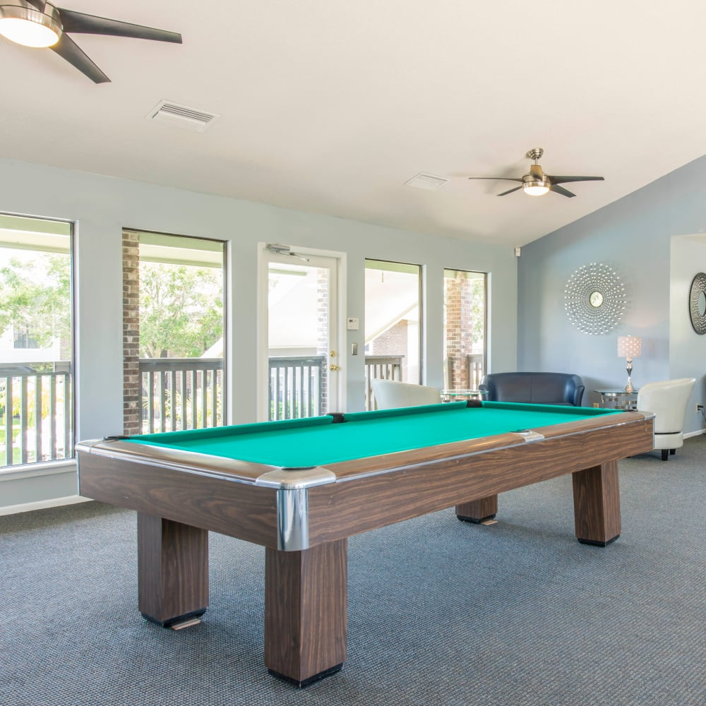 Resident clubhouse with a billiards table at Compass in Melbourne, Florida