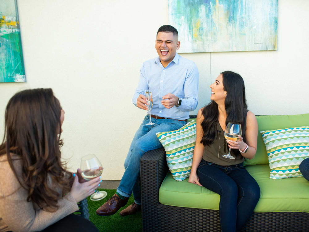 Residents enjoying wine at a high-end restaurant lounge near Lakeside Drive Apartments in Tempe, Arizona