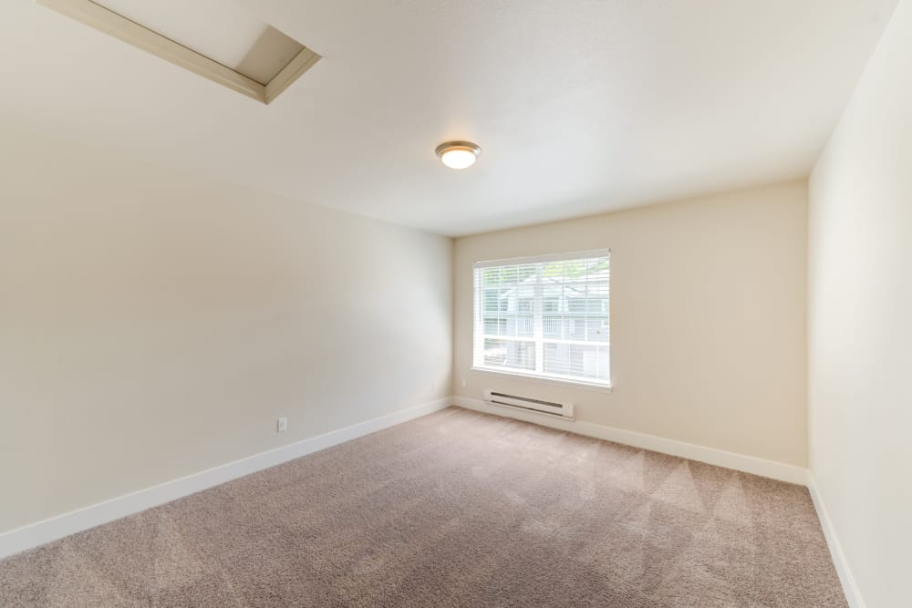 Spacious master bedroom at Bradley Park Apartments in Puyallup, Washington