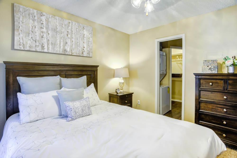 Bedroom at Enclave at Water's Edge Apartments in Austin, Texas