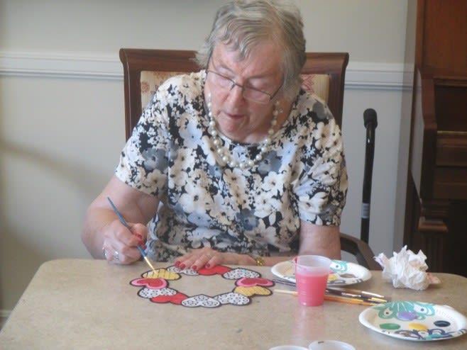A resident making art