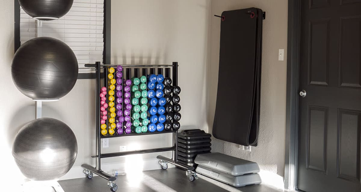 Free weights in the fitness center at Greentree Apartments  in  Carrollton, Texas