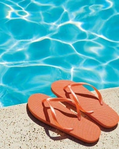Flip flops next to the pool at The Residences at Covered Bridge in Liverpool, New York