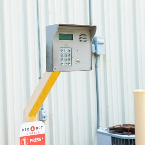 Secure entry keypad outside storage units at Red Dot Storage in Woodstock, Illinois