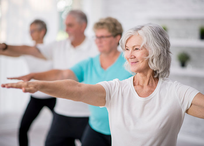 Seniors exercising at Avenida Naperville senior living apartments in Naperville, Illinois