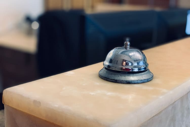 Service bell on the front desk at The Heights at Park Lane in Dallas, Texas