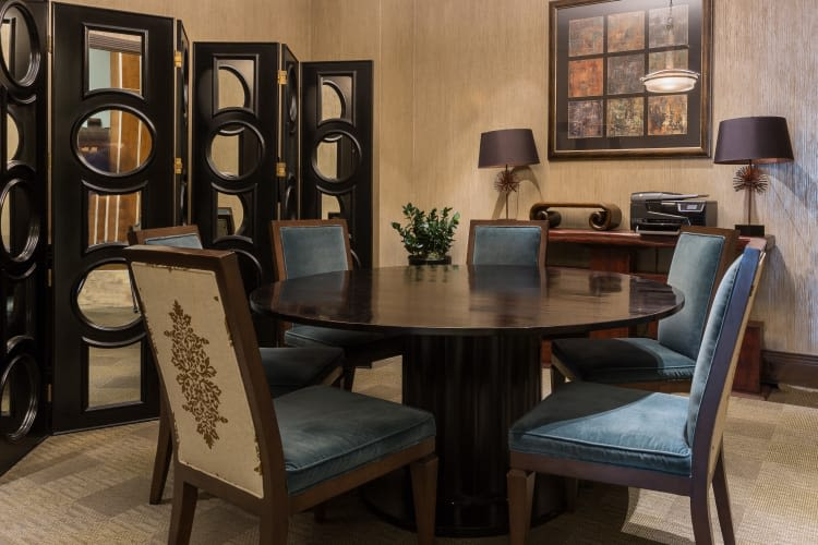 Model dining room with dark furniture at The Heights at Park Lane in Dallas, Texas