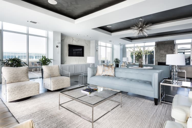 Spacious living room with baby blue couch at The Heights at Park Lane in Dallas, Texas
