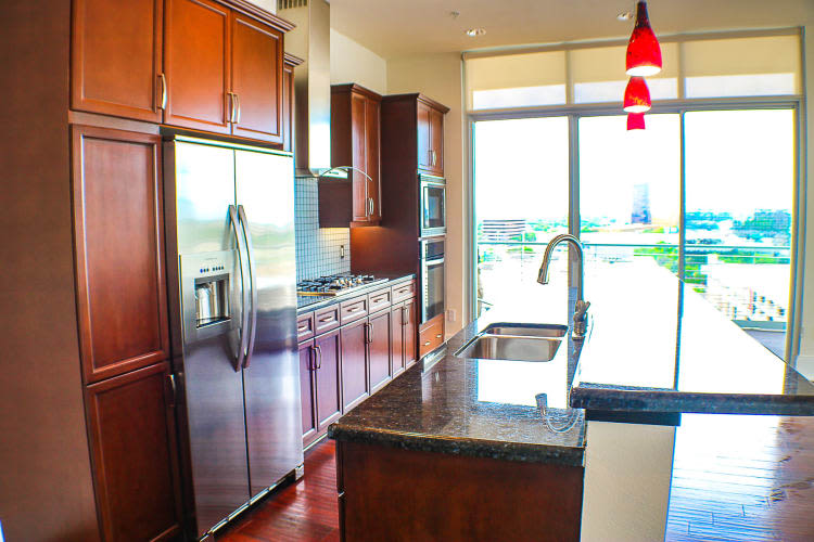 Kitchen with granite counter tops at The Heights at Park Lane in Dallas, Texas