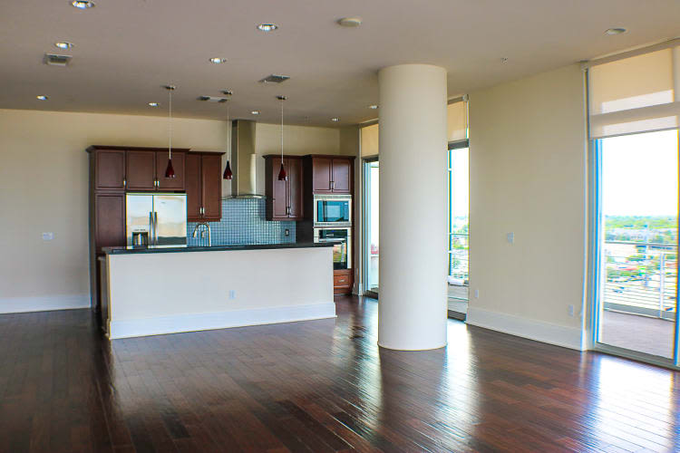 Spacious kitchen with hard wood flooring at The Heights at Park Lane in Dallas, Texas
