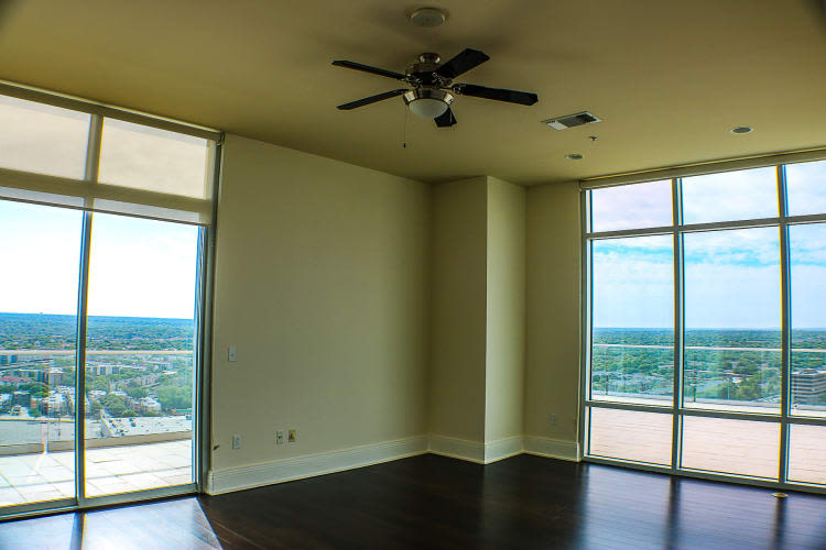 Spacious living area with ceiling fan at The Heights at Park Lane in Dallas, Texas